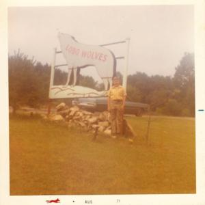 Ron Stafford and Lobo Wolves Sign [Photograph]