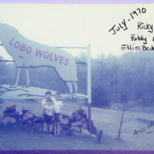 Three Boys and the Lobo Wolves Sign [Photograph]